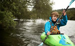Boy kayaking in yak summer kit